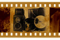 Old 35mm frame photo with camera Royalty Free Stock Photo