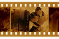 Old 35mm frame photo with film tape Royalty Free Stock Photo