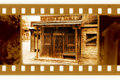 Old 35mm frame photo with vintage sheriff house Royalty Free Stock Photo