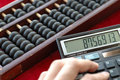 Old abacus and modern calculat Royalty Free Stock Photo