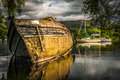 Old abandoned boat on the rippling loch ness lake in Scotland Royalty Free Stock Photo