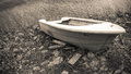 Old abandoned boat is the shore of the lake Stock Photo
