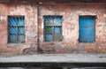 Old abandoned building wall texture blue windows Stock Images