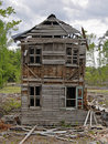 Old abandoned collapsing house cloudy day Royalty Free Stock Photo