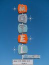 Old abandoned highway motel sign colorful in front of an Royalty Free Stock Photo