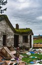 Old abandoned house in disrepair on cold day. Ruined house before final demolition Royalty Free Stock Photo