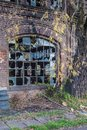Old abandoned industrial building with broken windows Royalty Free Stock Photo