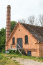 Old abandoned industry brick building with chimney Stock Image