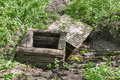 Old abandoned manhole well in the forest Royalty Free Stock Photo