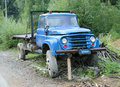 Old abandoned truck picture of a used to transport logs Stock Photos