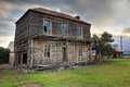 Old abandoned two storey wooden farmhouse Royalty Free Stock Photo