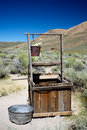 Old Abandoned Well and Bucket Stock Images