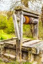 Old abandoned wooden well with beautiful structure on countryside. Royalty Free Stock Photo