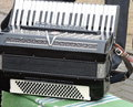 Old accordion on bench lithuania Royalty Free Stock Photo