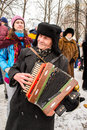 An old accordion players dressed in a Russian Ushanka