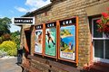 Old adverts on railway station wall, Arley. Royalty Free Stock Photo