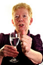 old age woman is holding a glass of water