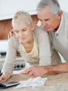 Old aged couple calculating their expenses Royalty Free Stock Photos