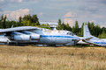 Old aircrafts on the abandoned aerodrome russian at in summertime cemetery of large and small aircraft near runway Royalty Free Stock Photography