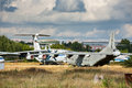 Old aircrafts on the abandoned aerodrome russian at in summertime cemetery of large and small aircraft near runway Stock Images
