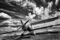 Old airplane on field. black and white Royalty Free Stock Photo
