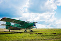 Old airplane on green grass Stock Photo