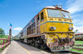 Old alsthom locomotive with passenger cars at kabinburi station thailand Royalty Free Stock Photos