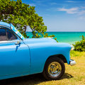 Old american car at a beach in Cuba Royalty Free Stock Photo