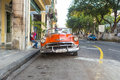 Old american car in a famous street in havana vintage red chevrolet parked near el prado these classic cars have become an iconic Royalty Free Stock Images
