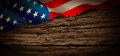 Old American flag on wooden background Royalty Free Stock Photo