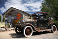 Old american ford beside vintage house Royalty Free Stock Photography