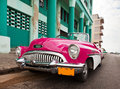 Old American retro car (50th years of the last century), an iconic sight in the city, on the Malecon street January 27, 2013 in O Royalty Free Stock Photo