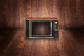 Old analog tv system on wooden floor Royalty Free Stock Photos