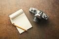 Old analogue camera and notepad Royalty Free Stock Photo