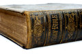 Old ancient bible close up shot of the spine of hardback with the words holy Stock Photo