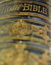 Old ancient bible close up shot of the spine of hardback with the words holy Royalty Free Stock Image