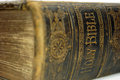 Old ancient bible close up shot of the spine of hardback with the words holy Stock Photography