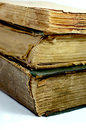 Old ancient books three on top of each other with the bindings damaged Royalty Free Stock Photo