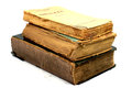 Old ancient books three on top of each other with the bindings damaged Royalty Free Stock Photography