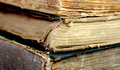 Old ancient books three on top of each other with the bindings damaged Royalty Free Stock Photos
