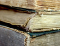 Old ancient books three on top of each other with the bindings damaged Royalty Free Stock Images