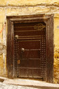 Old ancient door to a arabic home. Fes, Morocco Royalty Free Stock Photo
