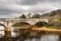 Old ancient stone bridge over calm river, beautiful Irish landscape. Scenic view. Royalty Free Stock Photo