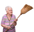 Old angry woman threatening with a broom on white background Royalty Free Stock Photos