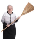 Old angry woman threatening with a broom on white background Stock Image