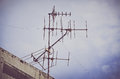 Old antenna with blue sky background vintage look filter silhouetted image television silhouetted Royalty Free Stock Photography