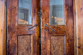 Old antique door for ships with the ship s many layers of brown varnish Royalty Free Stock Photography