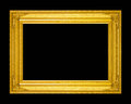 Old antique gold frame isolated on a black background. Royalty Free Stock Photo