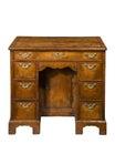 Old antique ladie`s kneehole walnut Georgian writing desk Royalty Free Stock Photo