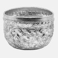 Old antique vintage water bowl on silver background made of stainless steel pumps ousted relief located in thailand Royalty Free Stock Photography